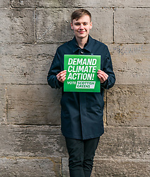 Hunter Square, Edinburgh, Scotland, United Kingdom, 28 November 2019. General Election: The Scottish Greens demand action about climate change as part of their general election campaign. Pictured: Cameron Glasgow, Scottish Green candidate for Livingston (and youngest Scottish candidate  at 19 years of age).<br /> Sally Anderson | EdinburghElitemedia.co.uk