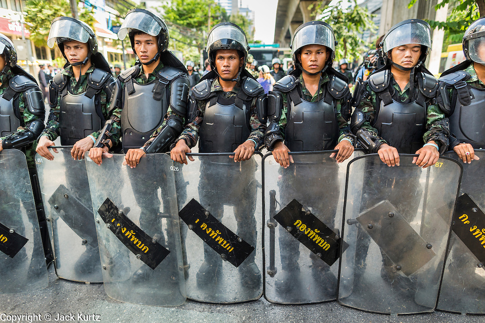 24 MAY 2014 - BANGKOK, THAILAND:  Thai riot police form a blocking line on Phahon Yothin Street in Bangkok. The police confronted anti-coup marchers and ordered them to leave the area. The protestors got on the Skytrain and took mass transit to another rallying site. There were several marches in different parts of Bangkok to protest the coup that unseated the popularly elected government. Soldiers and police confronted protestors and made several arrests but most of the protests were peaceful. The military junta also announced that firing of several police commanders and dissolution of the Thai Senate. The junta also changed its name from National Peace and Order Maintaining Council (NPOMC) to the National Council for Peace and Order (NCPO).  PHOTO BY JACK KURTZ