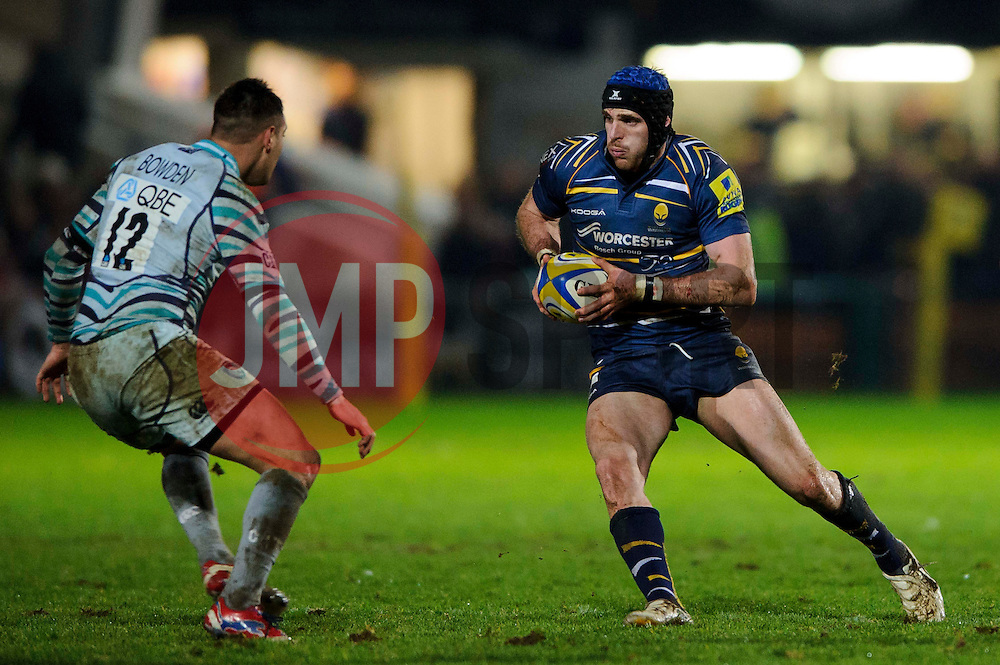 Worcester Inside Centre (#12) Jon Clarke runs at Leicester Inside Centre (#12) Dan Bowden during the first half of the match - Photo mandatory by-line: Rogan Thomson/JMP - Tel: Mobile: 07966 386802 04/01/2012 - SPORT - RUGBY - Sixways - Worcester. Worcester Warriors v Leicester Tigers - Aviva Premiership.