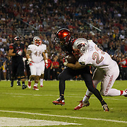 08 October 2016: The San Diego State Aztecs football team open's up the mountain west conference season at home against the University of Nevada Las Vegas Rebels. San Diego State running back Donnel Pumphrey (19) drags UNLV linebacker Matt lea into the end zone for a touchdown in the third quarter. The Aztecs beat the Rebels 26-7 to improve to 4-1 and 1-0 in conference play. www.sdsuaztecphotos.com
