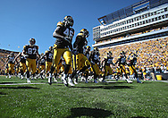 September 4 2010: The Iowa Hawkeyes take the field before the NCAA football game between the Eastern Illinois Panthers and the Iowa Hawkeyes at Kinnick Stadium in Iowa City, Iowa on Saturday September 4, 2010. Iowa defeated Eastern Illinois 37-7.