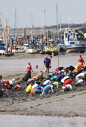 Competitors  taking part in the Maldon Mud race in Essex, Sunday, 5th May 2013  Photo by :  Max Nash / i-Images