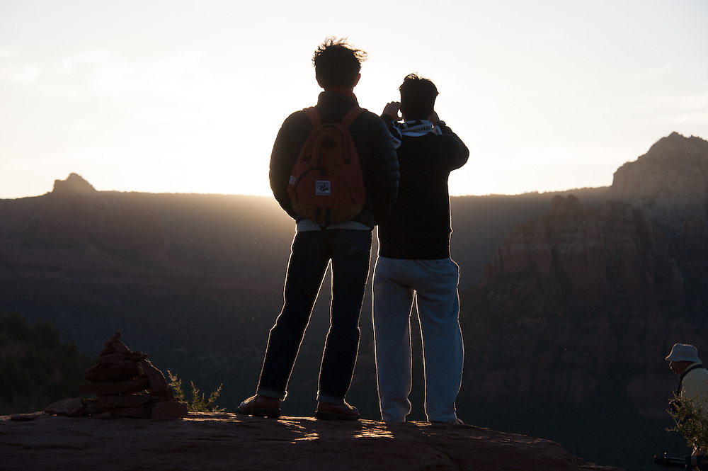 Tourists taking Picture of sunrise in Sedona AZ