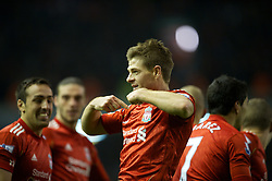 LIVERPOOL, ENGLAND - Tuesday, March 13, 2012: Liverpool's captain Steven Gerrard celebrates scoring the second of his hat-trick of goals against Everton on his 400th Premier Leagie appearance during the Premiership match at Anfield. Liverpool won 3-0 and Gerrard became the first player since Ian Rush in 1982 to score a hat-trick in a Merseyside Derby. (Pic by David Rawcliffe/Propaganda)