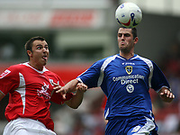 Photo: Rich Eaton.<br /> <br /> Barnsley v Cardiff City. Coca Cola Championship.<br /> <br /> 05/08/2006.Barnsleys  Antony Kay and Steve Thompson fight for the ball