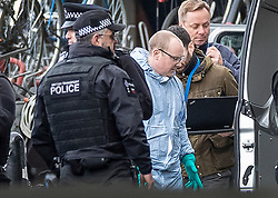 © Licensed to London News Pictures. 05/03/2019. London, UK. A forensics officer stands with uniformed colleagues at Waterloo Station as police deal with a suspicious package. The Metropolitan Police counter terrorism command has said that small improvised explosive devices have been found at the station, at Heathrow and London City airport. Photo credit: Peter Macdiarmid/LNP