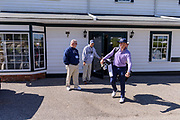 Justin Thomas emerges from the pro shop after his first interview of the day to greet players at the 18th green as he hosts the Strategic Communications/Justin Thomas Junior Championship presented by Phocus at Harmony Landing Country Club Friday, April 20, 2018, in Goshen, Ky. (Photo by Brian Bohannon)