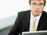 Businessman sitting at office desk portrait