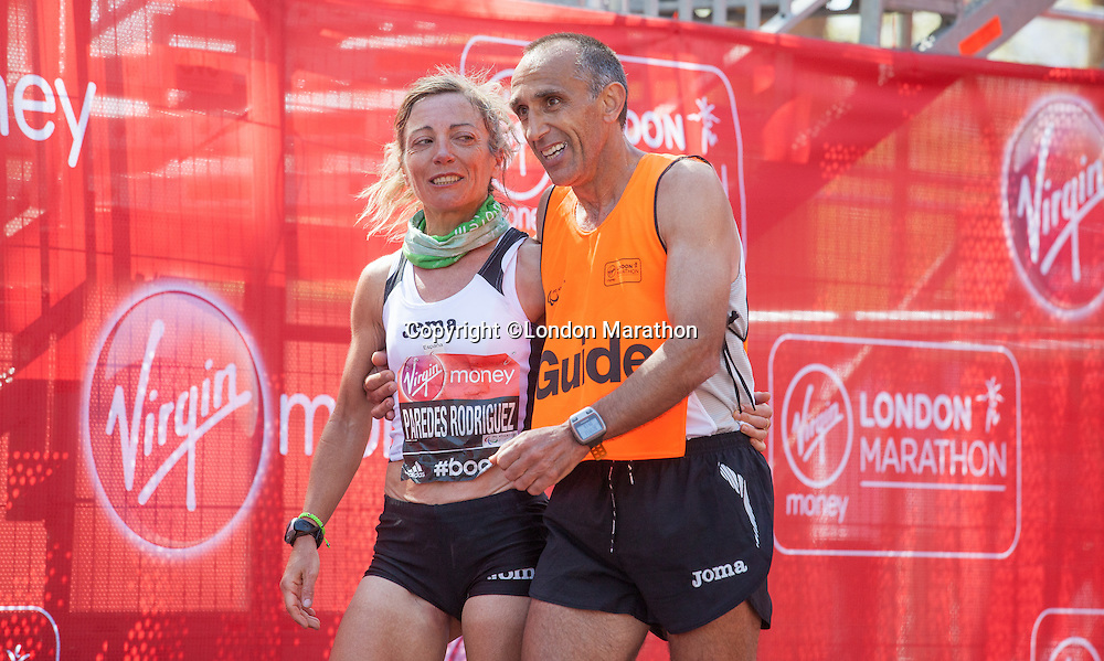 Maria Paredes Rodriguez and her guide having finished first in the IPC World Cup - Women's T11 - T12 at the end of the Virgin Money London Marathon 2014 on Sunday 13 April 2014<br /> Photo: Roger Allan/Virgin Money London Marathon<br /> media@london-marathon.co.uk