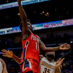Dec 6, 2017; New Orleans, LA, USA; New Orleans Pelicans guard Jrue Holiday (11) shoots over Denver Nuggets forward Kenneth Faried (35) during the second half at the Smoothie King Center. The Pelicans defeated the Nuggets 123-114. Mandatory Credit: Derick E. Hingle-USA TODAY Sports