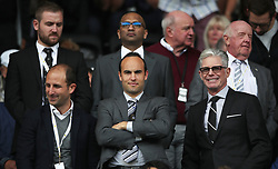 Former USA player Landon Donovan (front centre) now Swansea City consultant and minor shareholder, at the Premier League club in the directors box during the Premier League match at the Liberty Stadium, Swansea.