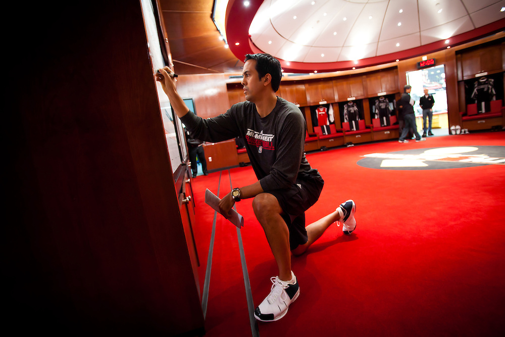 MIAMI, FL -- January 29, 2012 -- Miami head coach Erik Spoelstra writes out plays for the days game in the Heat's locker room prior to their 97-93 win over the Chicago Bulls at American Airlines Arena in Miami, Fla., on Sunday, January 29, 2012.  (Chip Litherland for ESPN the Magazine)