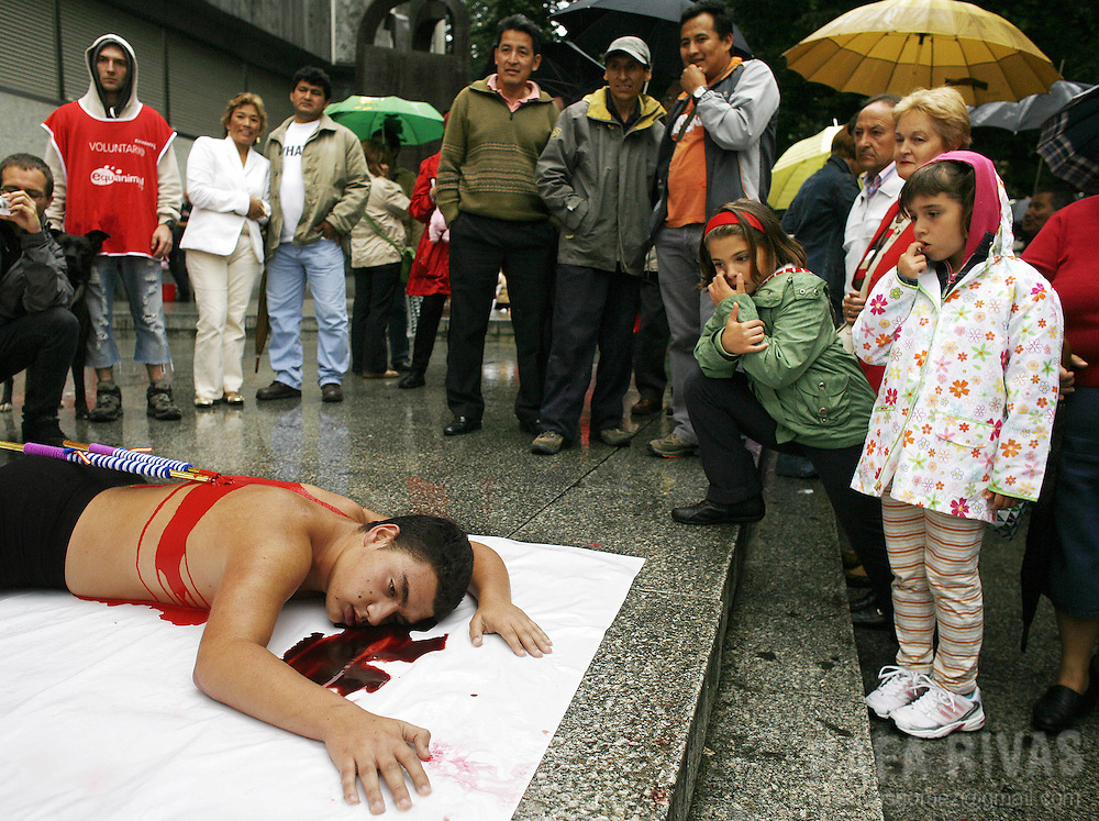 Pro animal rights activists protest against bullfighting during a performance called by pro animal rights group Equanimal, 23 August 2007, in Bilbao, northern Spain.