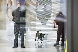 © Licensed to London News Pictures. 18/10/2019. Manchester, UK. Police use a trained search dog inside the Arndale Centre . Armed police and paramedics respond and the Arndale Centre and surrounding streets in Manchester City Centre are evacuated after reports of a man armed with a knife in the shopping centre . Photo credit: Joel Goodman/LNP
