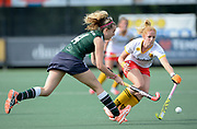 Surbiton's Oliva Chilton about to lose out in the challeneg to Den Bosch's Margot van Geffen during their semi final of the EHCC 2017 at Den Bosch HC, The Netherlands, 3rd June 2017