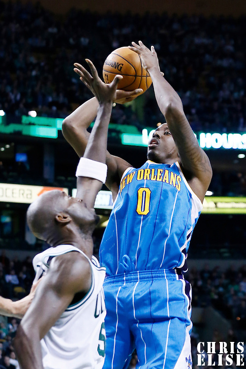16 January 2013: New Orleans Hornets small forward Al-Farouq Aminu (0) takes a jumpshot over Boston Celtics power forward Kevin Garnett (5) during the New Orleans Hornets 90-78 victory over the Boston Celtics at the TD Garden, Boston, Massachusetts, USA.
