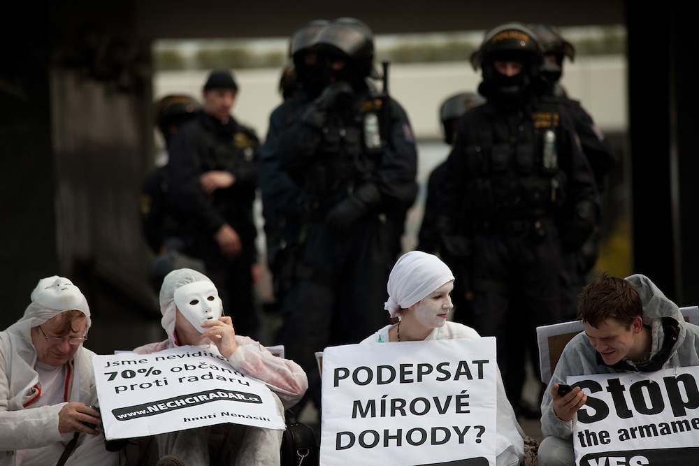 """Protesters of an organisation called """"Humanist Movement"""" at the metro station Vysehrad close to the Prague Congress Center where the EU-US summit with Barack Obama took place. They are watched by special forces of the Czech police."""