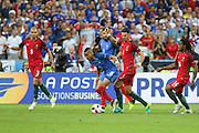 France Midfielder Dimitri Payet battles for the ball during the Euro 2016 final between Portugal and France at Stade de France, Saint-Denis, Paris, France on 10 July 2016. Photo by Phil Duncan.