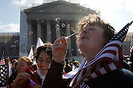 Protestors Ellena Popova (C) and Seosamh Hackett blow bubbles as they rally against the Defense of Marriage Act in front of the U.S. Supreme Court in Washington.