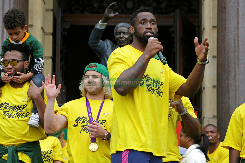 Monday 11th November 2019.<br /> City Hall, Grand Parade,<br /> And City Centre, Cape Town,<br /> Western Cape,<br /> South Africa.<br /> <br /> SPRINGBOKS CELEBRATE WINNING THE RUGBY WORLD CUP CHAMPIONSHIP IN 2019 WITH A COUNTRYWIDE VICTORY TOUR!<br /> <br /> SPRINGBOKS RUGBY WORLD CUP VICTORY TOUR CAPE TOWN!<br /> <br /> The Springboks take the stage outside the City Hall as they are cheered on by thousands of excited fans. South African Captain Siya Kolisi (centre) speaks from his heart to the crowd during the festivities prepared for them.<br /> <br /> The reigning Rugby World Cup Champions namely the South African Springbok Rugby Team, celebrates winning the Webb Ellis Cup during the International Rugby Football Board Rugby World Cup Championship held in Japan in 2019 with their Victory Tour that culminated in the final city tour taking place in Cape Town. Thousands of South African fans filled the streets of the city all trying their best to show their support for their beloved Springboks and to celebrate them winning the Rugby World Cup for the third time. South Africa previously won the Rugby World Cup in 1995, 2007 and now again in 2019. South African Springbok Captan Siya Kolisi took the opportunity to speak to the gathered crowd about how something like this brings unity and that we should live together as a nation that practices what is known as ubuntu. Ubuntu is a quality that includes the essential human virtues of compassion and humanity. This image taken in Cape Town on Monday 11th November 2019.<br /> <br /> This image is the property of Seven Bang Media Group (Pty) Ltd, hereinafter referred to as SBM.<br /> <br /> Picture By: SBM / Mark Wessels. (11/11/2019).<br /> +27 (0)61 547 2729<br /> mark@sevenbang.com<br /> www.sevnbang.com<br /> <br /> Copyright © SBM. All Rights Reserved.