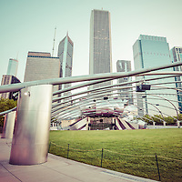 Chicago Skyline with Pritzker Pavilion vintage picture. Jay Pritzker Pavilion is an outdoor concert venue in downtown Chicago. Photo includes Grant Park, Millenium Park, Crain Communications building, Aon Center Building, Prudential Plaza, Prudential Tower, Aqua Building, and Blue Cross Blue Shield building. Image is toned with vintage Instagram style.