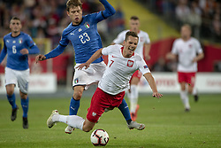 October 14, 2018 - Chorzow, Poland - Arkadiusz Milik of Poland fouled by Nicolo Barella of Italy during the UEFA Nations League A match between Poland and Italy at Silesian Stadium in Chorzow, Poland on October 14, 2018  (Credit Image: © Andrew Surma/NurPhoto via ZUMA Press)