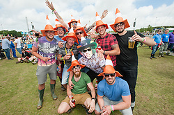 © Licensed to London News Pictures. 13/06/2015. Isle of Wight, UK.  A group of festival goers wearing traffic cone hats watch Nothing but Thieves perform at Isle of Wight Festival 2015 on Saturday Day 3 in the warm afternoon sun.  Yesterday suffered torrential rain all afternoon and evening, after a first day of warm sun.  This years festival include headline artists the Prodigy, Blur and Fleetwood Mac.  Photo credit : Richard Isaac/LNP