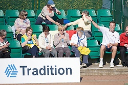 NOTTINGHAM, ENGLAND - Thursday, June 11, 2009: Greg Rusedski (GBR) tries to get a fan to take his racquet and try playing a point on day one of the Tradition Nottingham Masters tennis event at the Nottingham Tennis Centre. (Pic by David Rawcliffe/Propaganda)