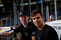 KELOWNA, CANADA - NOVEMBER 14: Kole Lind #16 and Marek Skvrne #9 of the Kelowna Rockets sit on the bench after pre-game warm up against the Edmonton Oil Kings on November 14, 2017 at Prospera Place in Kelowna, British Columbia, Canada.  (Photo by Marissa Baecker/Shoot the Breeze)  *** Local Caption ***