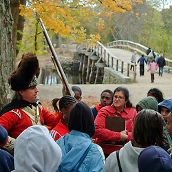 Redcoat costumed interpreter with middle school group at Revolutionary War historic site the North Bridge, Minute Man National Historic Park, Concord, MA.Editorial use only. Not released.