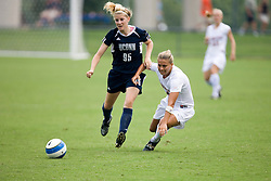Virginia Cavaliers M/F Shannon Foley (5) battles UCONN's M Becky Gundling (95)...The Virginia Cavaliers fell 2-1 the University of Connecticut Huskies in a pre-season exhibition match at Klockner Stadium in Charlottesville, VA on August 26, 2007.
