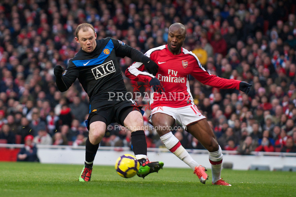 LONDON, ENGLAND - Sunday, January 31, 2010: Arsenal's William Gallas and Manchester United's Wayne Rooney during the Premiership match at the Emirates Stadium. (Photo by Chris Brunskill/Propaganda)