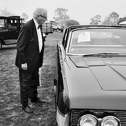 "After Pebble Beach Concours d'Elegance 2008, this man shuffling across the 9 hole course ""Peter Hay"". He stopped and studied the specifications of this car."