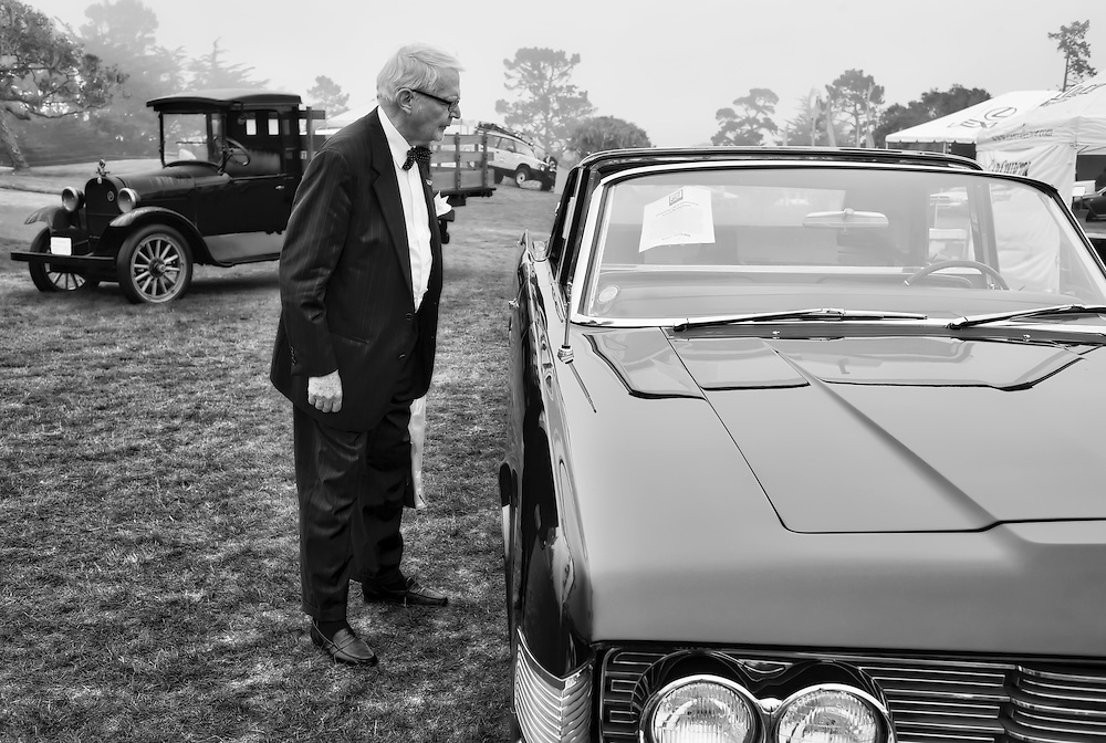 """After Pebble Beach Concours d'Elegance 2008, this man shuffling across the 9 hole course """"Peter Hay"""". He stopped and studied the specifications of this car."""