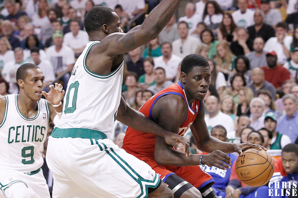 26 May 2012: Philadelphia Sixers point guard Jrue Holiday (11) drives past Boston Celtics power forward Brandon Bass (30) during the Boston Celtics 85-75 victory over the Philadelphia Sixer, in Game 7 of the Eastern Conference semifinals playoff series, at the TD Banknorth Garden, Boston, Massachusetts, USA.