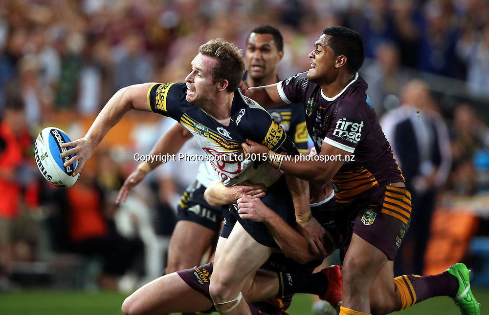 Michael Morgan gets the final pass away for the match leveling try from Anthony Milford<br /> Broncos v Cowboys NRL Grand Final rugby league match at ANZ Stadium, Homebush Australia. Sunday 4 October 2015. Photo: Paul Seiser/Photosport.nz