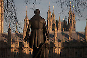"The statue of Sir Robert Peel and the British Houses of Parliament, on 17th January 2017, in Parliament Square, London England. The Elizabeth Tower (previously called the Clock Tower) named in tribute to Queen Elizabeth II in her Diamond Jubilee year – was raised as a part of Charles Barry's design for a new palace, after the old Palace of Westminster was largely destroyed by fire on the night of 16 October 1834. The new Parliament was built in a Neo-gothic style, completed in 1858 and is one of the most prominent symbols of both London and England. Sir Robert Peel, was a British statesman and member of the Conservative Party, served twice as Prime Minister of the United Kingdom and twice as Home Secretary. He created the modern police force and officers known as ""bobbies"" and ""peelers"""