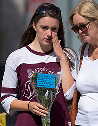 © Licensed to London News Pictures. 22/06/2020. Reading, UK. 18 year old Emily and her mother Sally observe a minutes silence near Forbury Gardens in Reading town centre, where three people were stabbed to death in a terrorist attack. Several other people were injured in the attack which was carried out by Libyan asylum seeker Khairi Saadallah, who is currently in custody. . Photo credit: Ben Cawthra/LNP