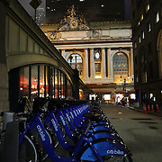 A Citi Bike docking station near Grand Central Terminal, Manhattan, New York. Citi Bike the NYC Bicycle Share Program sponsored by Citi Bank, launched in late May 2013 giving access to thousands of bikes at docking stations throughout  Manhattan and parts of Brooklyn. Manhattan, New York, USA. 4th June 2013. Photo Tim Clayton