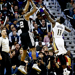 Mar 3, 2017; New Orleans, LA, USA; San Antonio Spurs forward Kawhi Leonard (2) shoots over New Orleans Pelicans guard Jrue Holiday (11) during the first quarter of a game at the Smoothie King Center. Mandatory Credit: Derick E. Hingle-USA TODAY Sports
