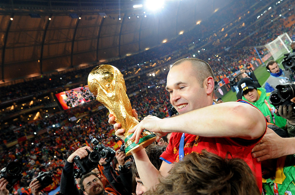 Spain's goal scorer Andreas Iniesta celebrates after winning the 2010 FIFA World Cup South Africa Final match between Netherlands and Spain at Soccer City Stadium on July 11, 2010 in Johannesburg, South Africa.