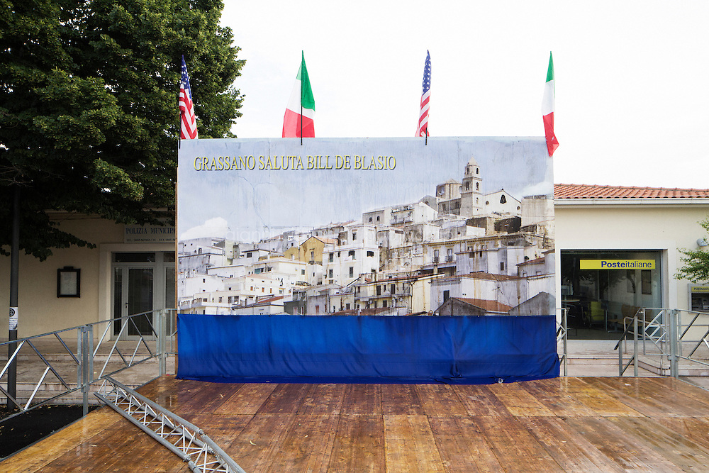 GRASSANO, ITALY - 24 JULY 2014: At the end of the day, a wet backdrop prepared for Mayor of New York Bill de Blasio's arrival waits to be disassembled  in Grassano, his ancestral home town in Italy, on July 24th 2014.<br /> <br /> New York City Mayor Bill de Blasio arrived in Italy with his family Sunday morning for an 8-day summer vacation that includes meetings with government officials and sightseeing in his ancestral homeland.
