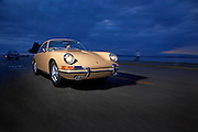 Image of a tan sports car on a road in Seattle, Washington, Pacific Northwest, Porsche 1967 911S, model and property released