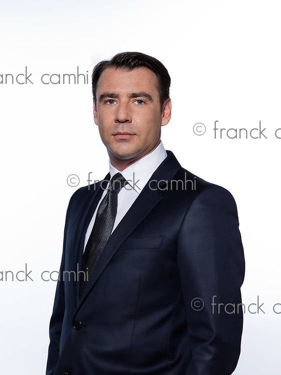 handsome caucasian man blank expression portrait isolated studio on white background wearing suit