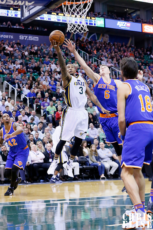 09 December 2015: Utah Jazz guard Trey Burke (3) goes for the layup past New York Knicks forward Kristaps Porzingis (6) during the Utah Jazz 106-85 victory over the New York Knicks, at the Vivint Smart Home Arena, Salt Lake City, Utah, USA.