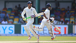 August 4, 2017 - Colombo, Sri Lanka - Indian cricketers Ravindra Jadeja and Wriddhiman Saha run between the wickets during the 2nd Day's play in the 2nd Test match between Sri Lanka and India at the SSC international cricket stadium at the capital city of Colombo, Sri Lanka on Friday 04 August 2017. (Credit Image: © Tharaka Basnayaka/NurPhoto via ZUMA Press)