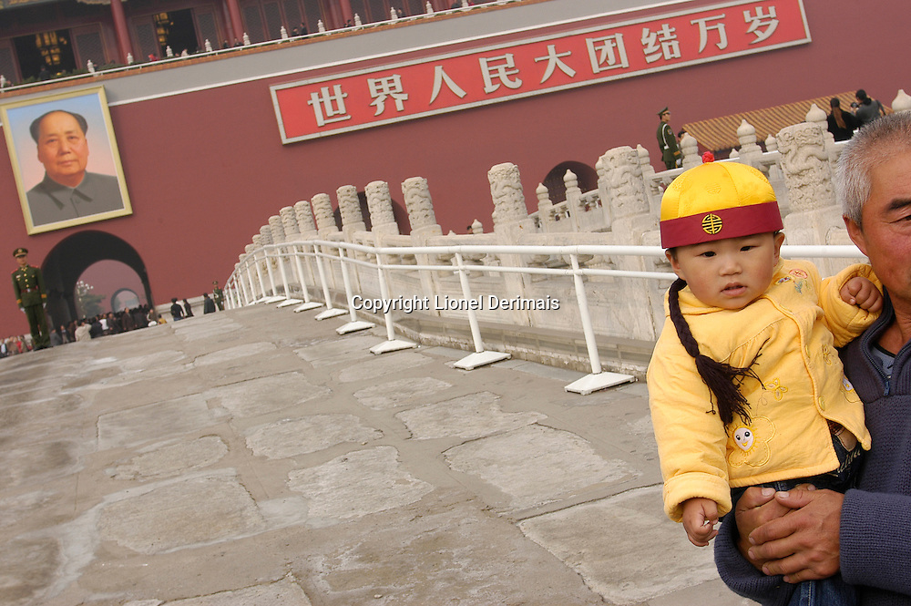 A young boy with his grand father on Tian'an men square, Beijing, China November 2005