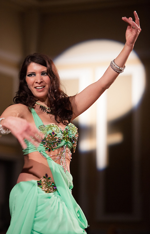 Ellie Olin dances during a Turkish drum performance at the Sixth Annual International Women's Day Festival, held in Baker Center Ballroom on March 16, 2014. The event, sponsored in part by the Ohio University Women's Center, educated audiences about women's progress, celebrated women's achievements, and included numerous performances by female members of the Athens and Ohio University community. International Women's Day itself fell on March 8, 2014. Photo by Lauren Pond