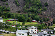 Bernina Express ascending on the circular viaduct at Brusio.