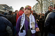 "A rally member looks on with a scarf. Rally members, remembering the death of editor-in-chief of the bilingual Turkish-Armenian newspaper Agos, Hrant Dink, wore scarves and held placards stating ""We are all Hrant, We are all Armenian""."